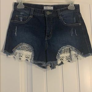 Rue 21, blue denim shorts with woven flowers